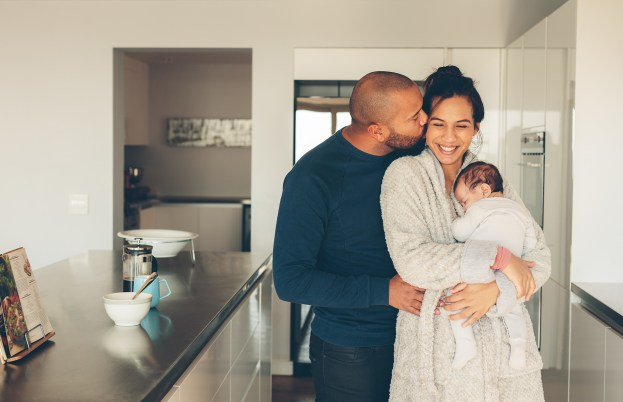 Lovely young family of three in kitchen