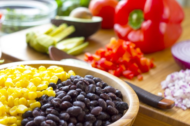 Ingredients for a mexican salad on wooden tableware