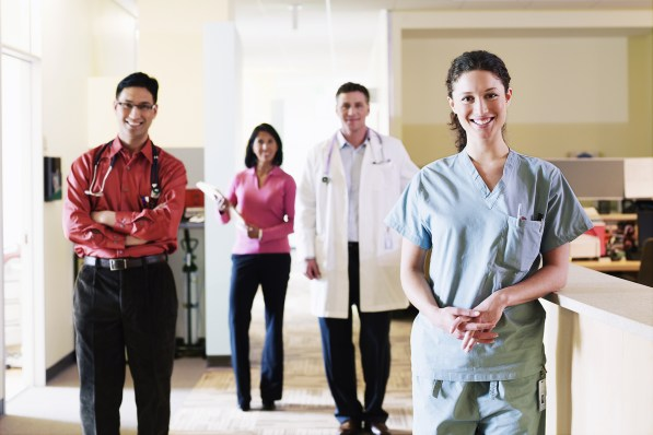 Group of health care professionals in medical center, smiling