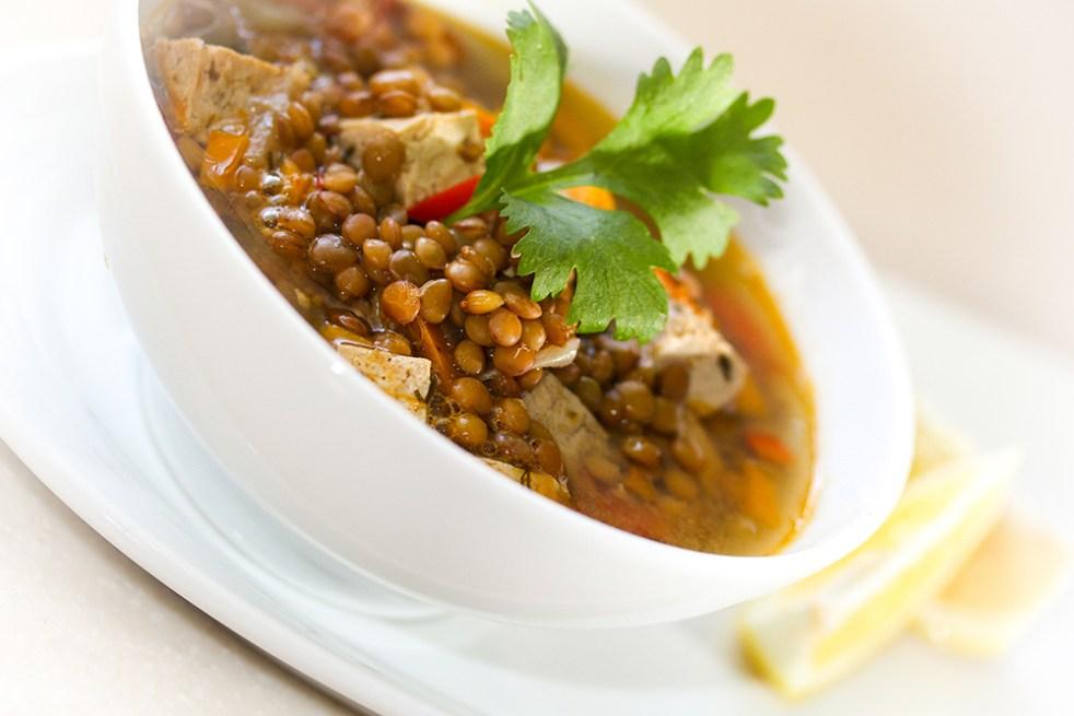 Vegetarian lentil tofu soup in a white bowl