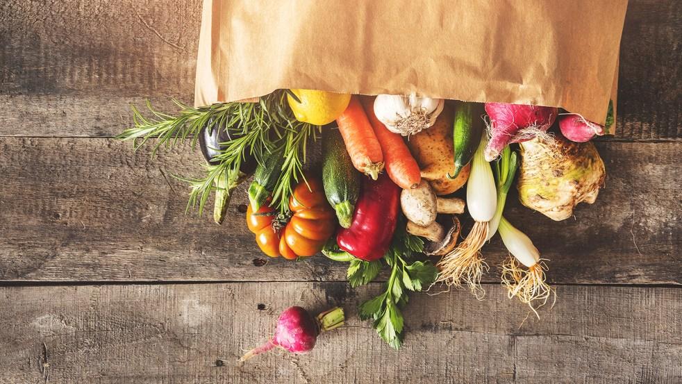 Fresh vegetables healthy food in a brown paper bag