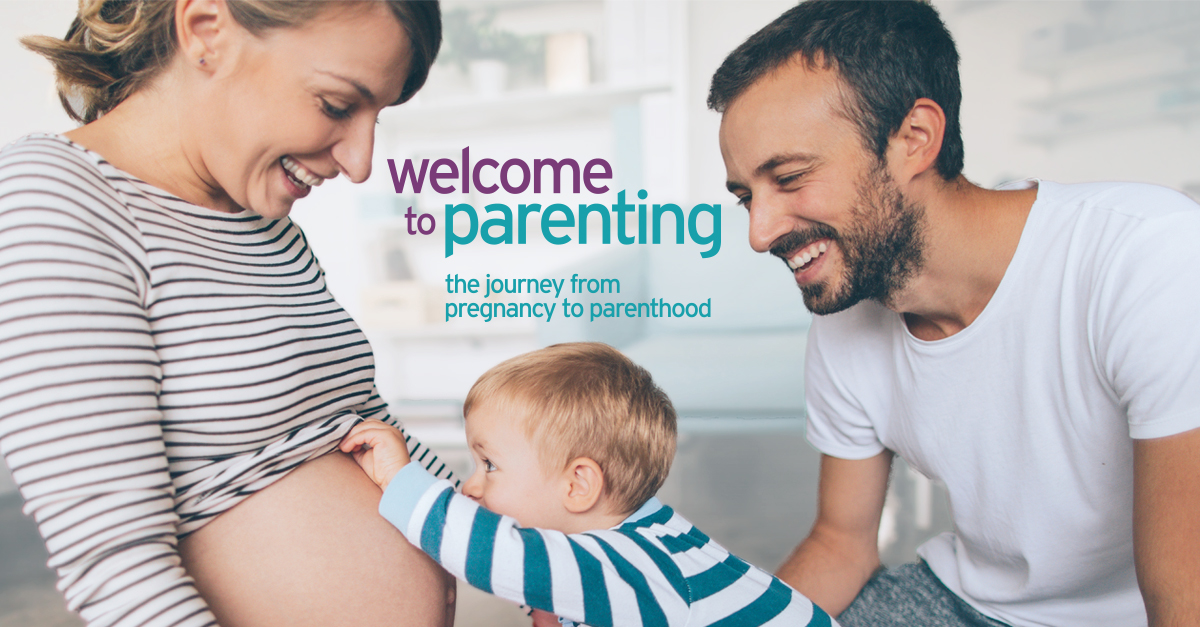 Parents with toddler looking at pregnant belly. Welcome to Parenting