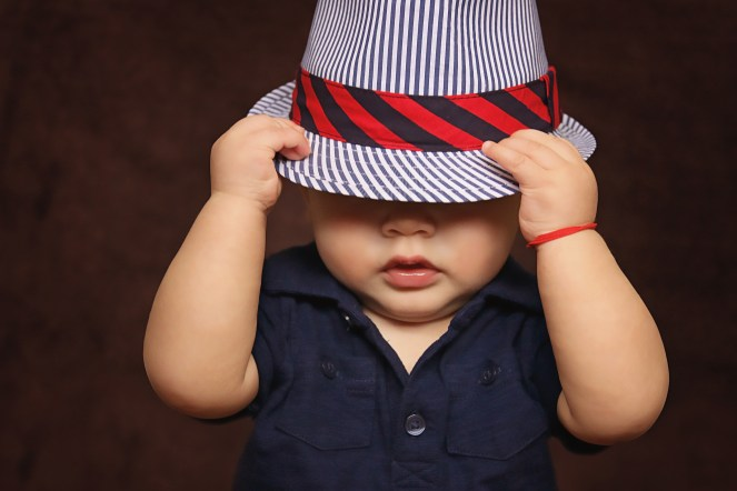 baby wear hat covered eyes
