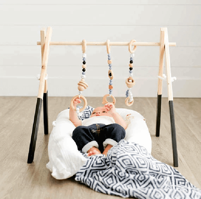 Non toxic wooden baby gym. Super cute gift for a new baby.