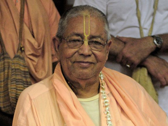 Srila-Govinda-Maharaj-Seated-Upright-in-a-chair