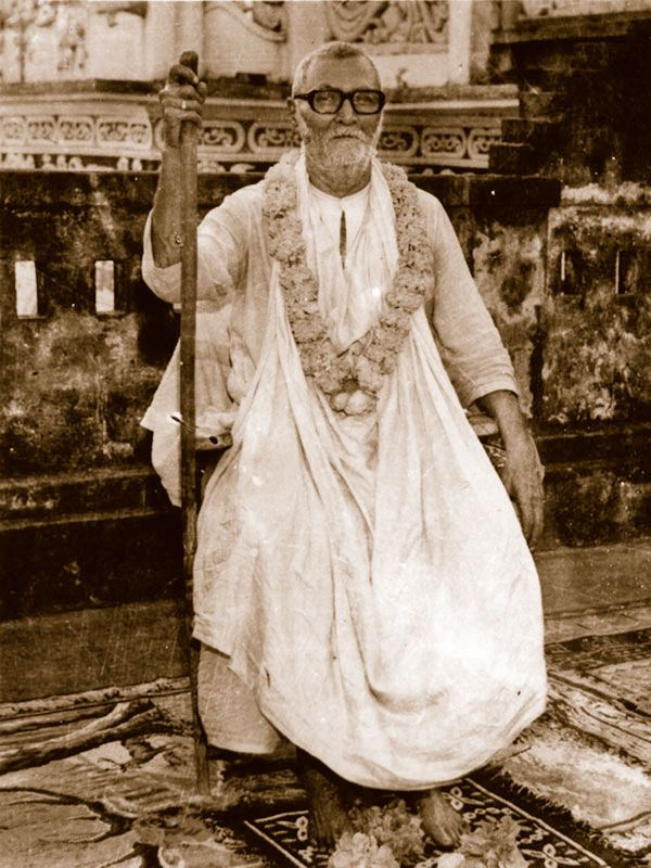 Srila-Sridhar-Maharaj-Seated-Outside-In-Chair-With-Staff