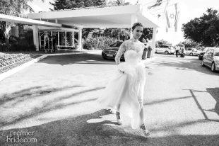 Bride walks to wedding in Designed by Inbal Dror