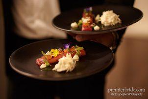 Salmon pearls served on black plates