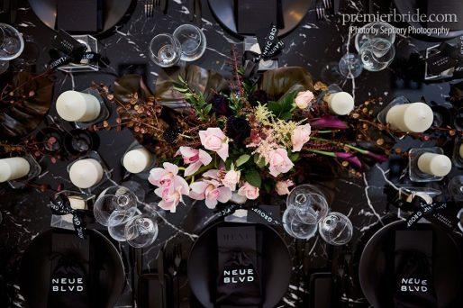 Peonies with black on black wedding reception
