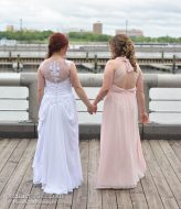 Bride with her bridesmaid on the waters edge