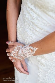 Boho white henna tattoos on arms and hands