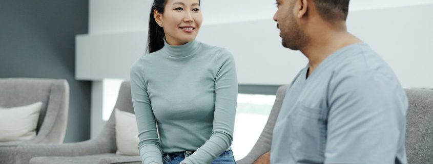 woman inquiring whether she's a good candidate for lipo