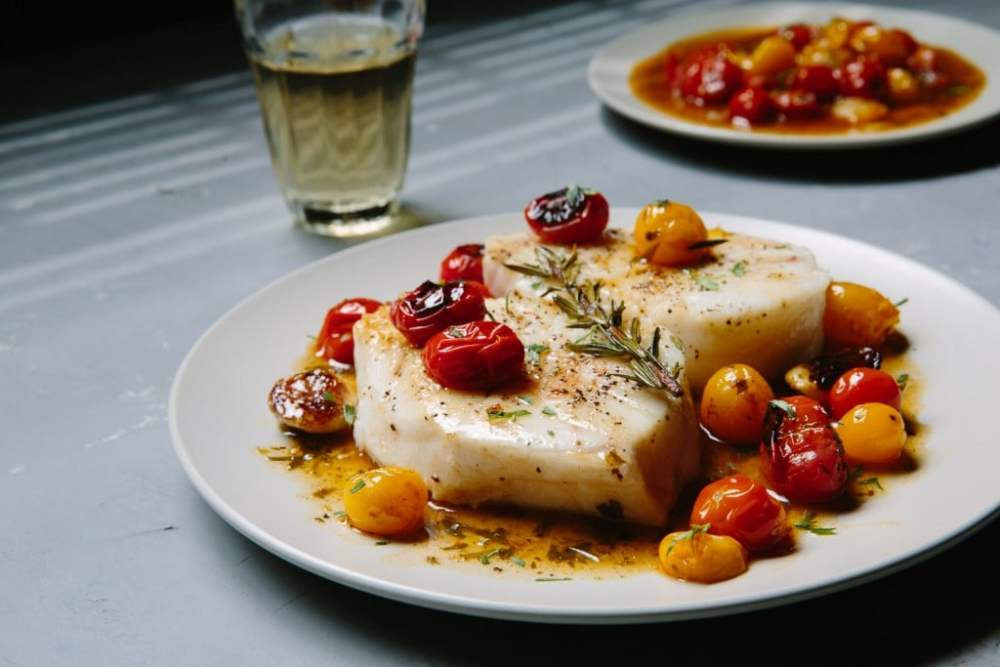 Fresh springtime Sea Bass recipe from Premier Meat Company. Cherry Tomato sauce and light lemon on fillet.