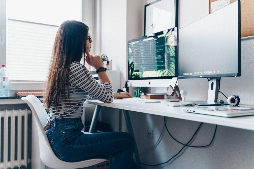 Woman at a computer desk