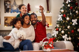 family taking selfie together around holiday decorations at home