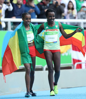 African Almaz Ayana smashed the world record to win the women's Olympic 10,000 metres race