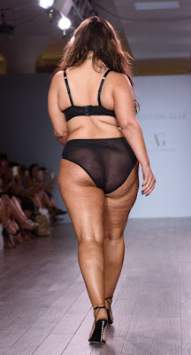 Ashley Graham Plus-size model Ashley Graham showcases her curves in black lace underwear on the runway at New York Fashion