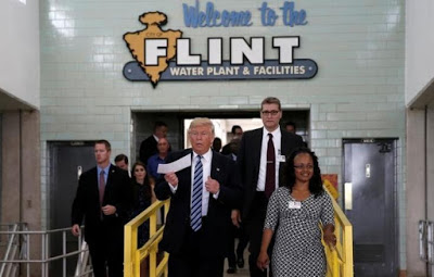 Trump embarrassed by Pastor during anti-Clinton remark in Flint