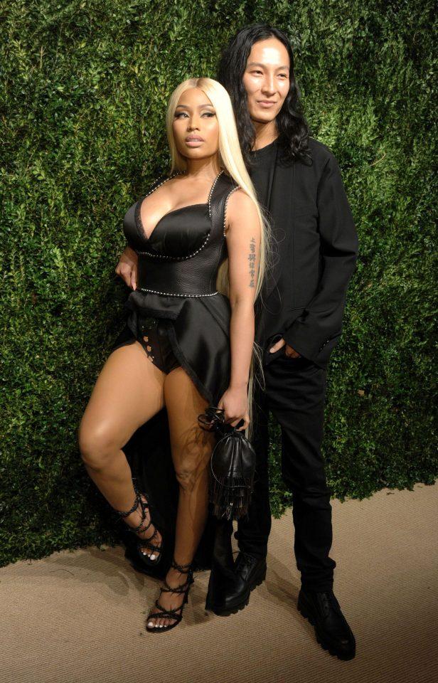 Nicki Minaj looks like a sexy superhero in a plunging leotard