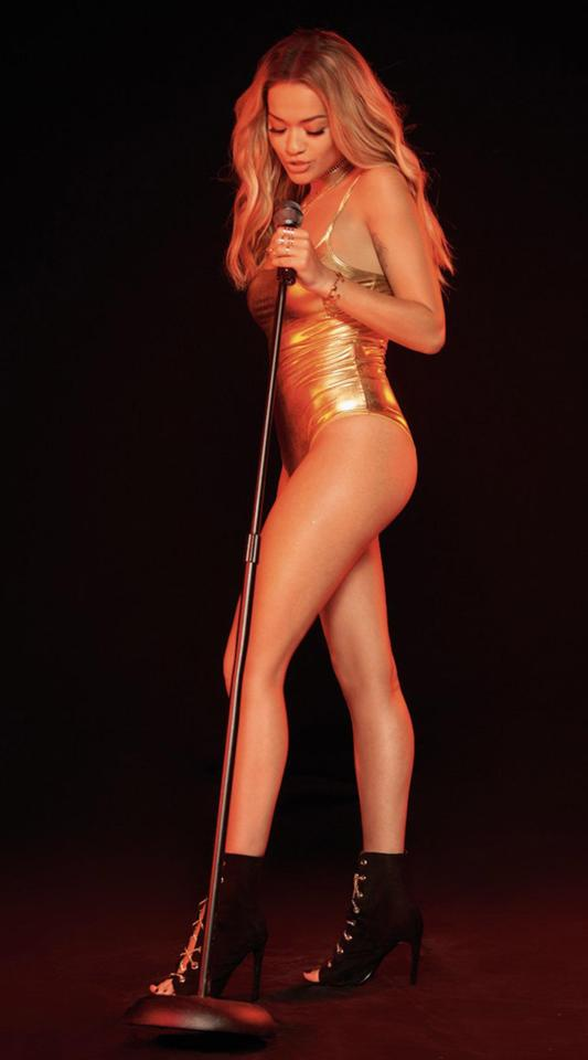 Rita Ora dazzles in a gold swimsuit and high-heeled boots