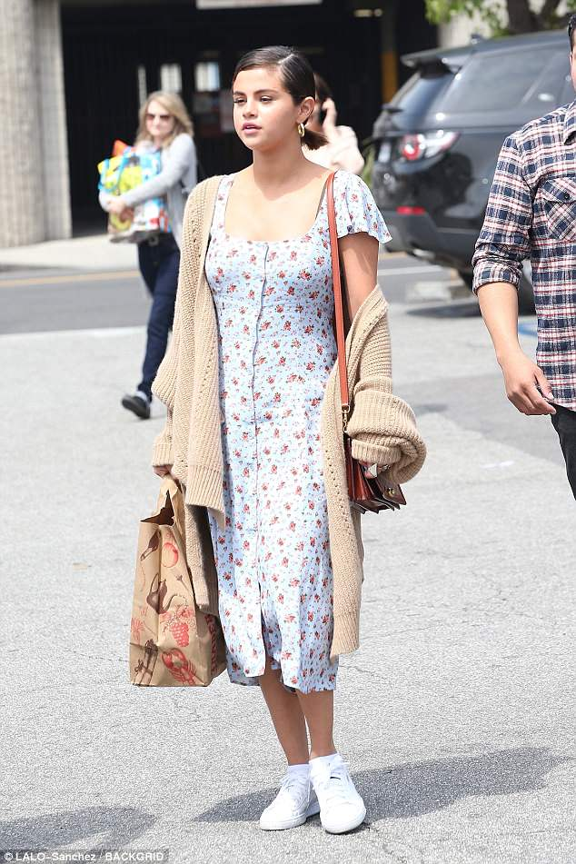 Selena Gomez dons floral dress and slouchy sweater for Easter Sunday church services in Los Angeles
