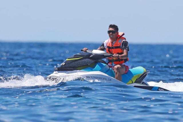 Liverpool star Roberto Firmino enjoys passionate kiss with wife Larissa Pereira on luxury yacht in Ibiza