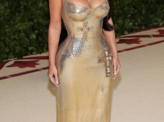 Kim Kardashian attends the 2018 Met Gala wearing sexy gold versace dress