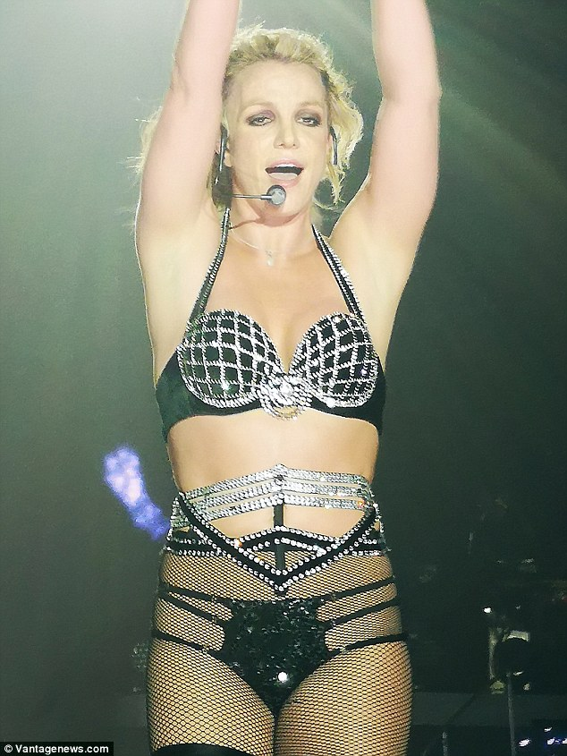 Britney Spears strips down to a barely-there underwear and bejeweled bra