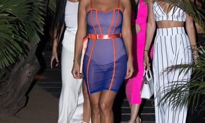 Kourtney Kardashian flaunts her curves in sexy sheer dress after sister Kim's nasty jibe (Photos)
