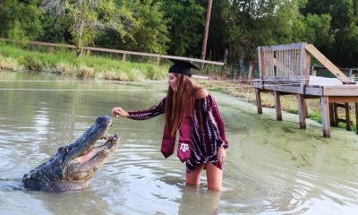 College student poses with a nearly 14-foot long and 1,000-pound alligator
