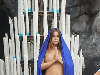 female artist strips completely naked at sacred Catholic site Lourdes in front of horrified believers