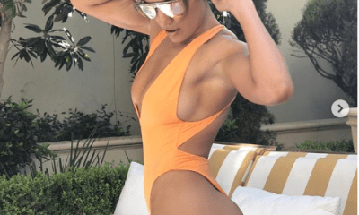 Jennifer Lopez flaunts her curves in revealing orange swimsuit (Photos)