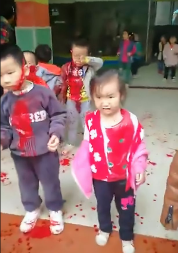 39-year-old woman armed with kitchen knife storms kindergarten and slashes 14 children (distressing footage)