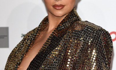 Demi Rose puts on a busty display in a sparkling gold mini dress