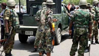 Nigerian soldiers arrest female bandit dancing with AK-47 rifle