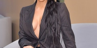 Kim Kardashian flaunts her cleavage in oversize matching suit