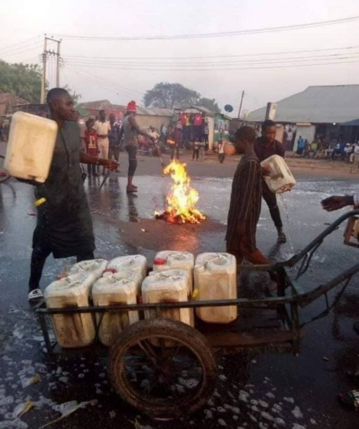 Kaduna state residents wash their streets with soap and water