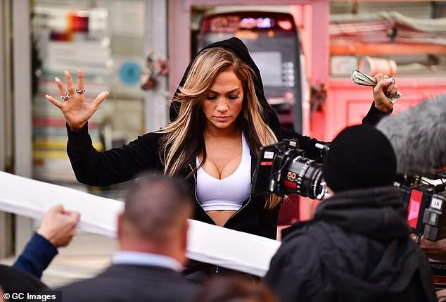 Jennifer Lopez looks phenomenal in a neon pink bikini on the set of her stripper film Hustlers