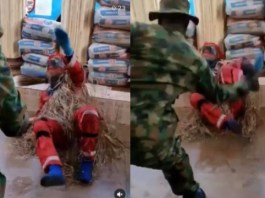 Masquerade pleads for mercy while being flogged by soldier (video)