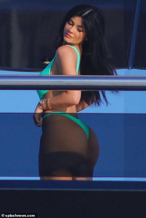 Kylie Jenner showcases her curves in tiny thong swimsuit