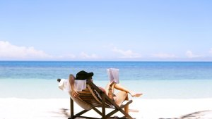 Person lounging on a beach.