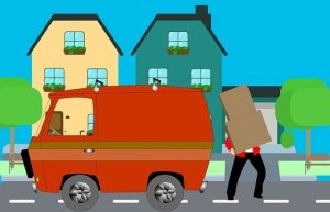 Reasons to avoid DIY relocation - man taking boxes in a van