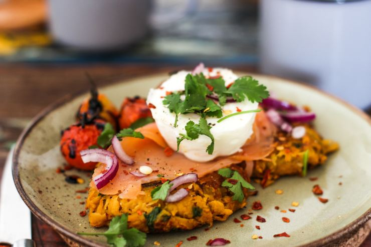 baked sweet potato with eggs, parsley and tomato