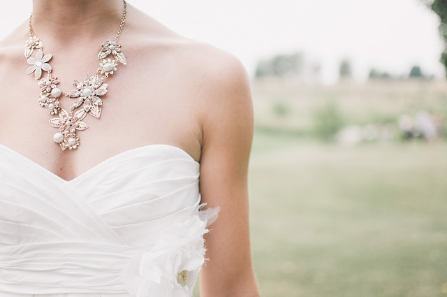 close up of a bride's dress on her wedding day
