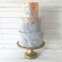 Wedding cake with copper frosting accents