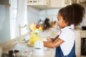 doing dishes as part of a family chore system