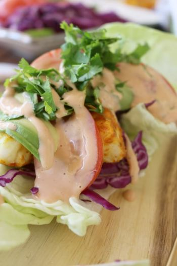 Cajun Fish Tacos with Zesty Dressing - can be enjoyed with sprouted tortillas or go paleo and use lettuce wraps. Check out the recipe!