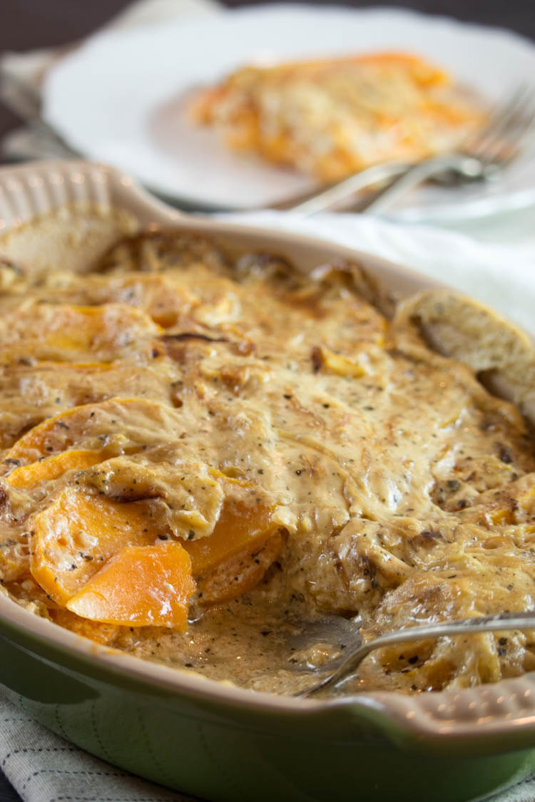 Scalloped Butternut Squash with Caramelized Onions Cream -Thinly sliced butternut squash is enveloped in a sea of caramelized onions and garlicky cream sauce. This side dish is loaded with amazing aroma and delicious flavors. #glutenfree #realfood #holidays