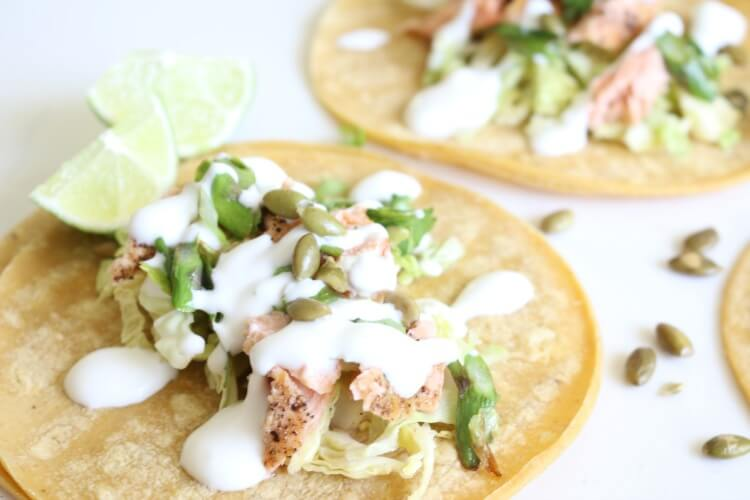 Seared Salmon Tacos with Asparagus Scallion Salsa and Lime Yogurt - these gluten free fish tacos are delicious and easy to make.
