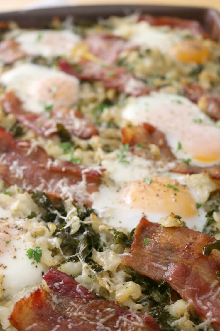Sheet Pan Breakfast with Kale, Bacon & Hash Brown - your favorite comfort food ingredients with added nutrition from kale made easily and hassle free on a sheet pan in the oven.